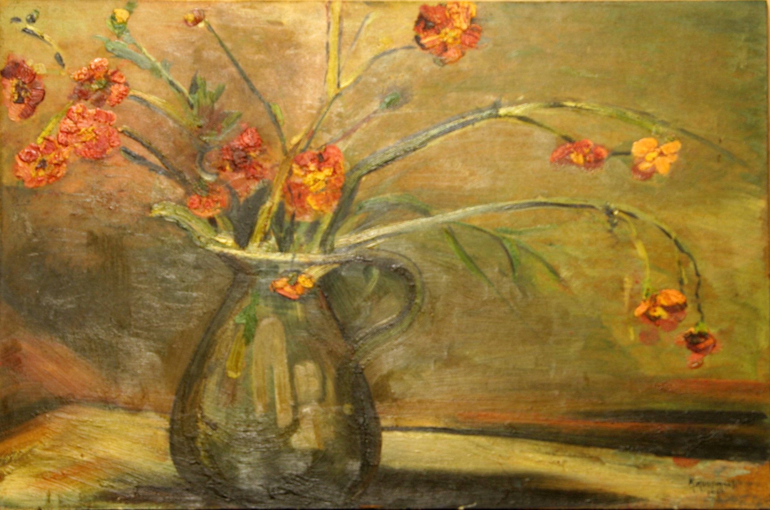 Een kan met bloemen