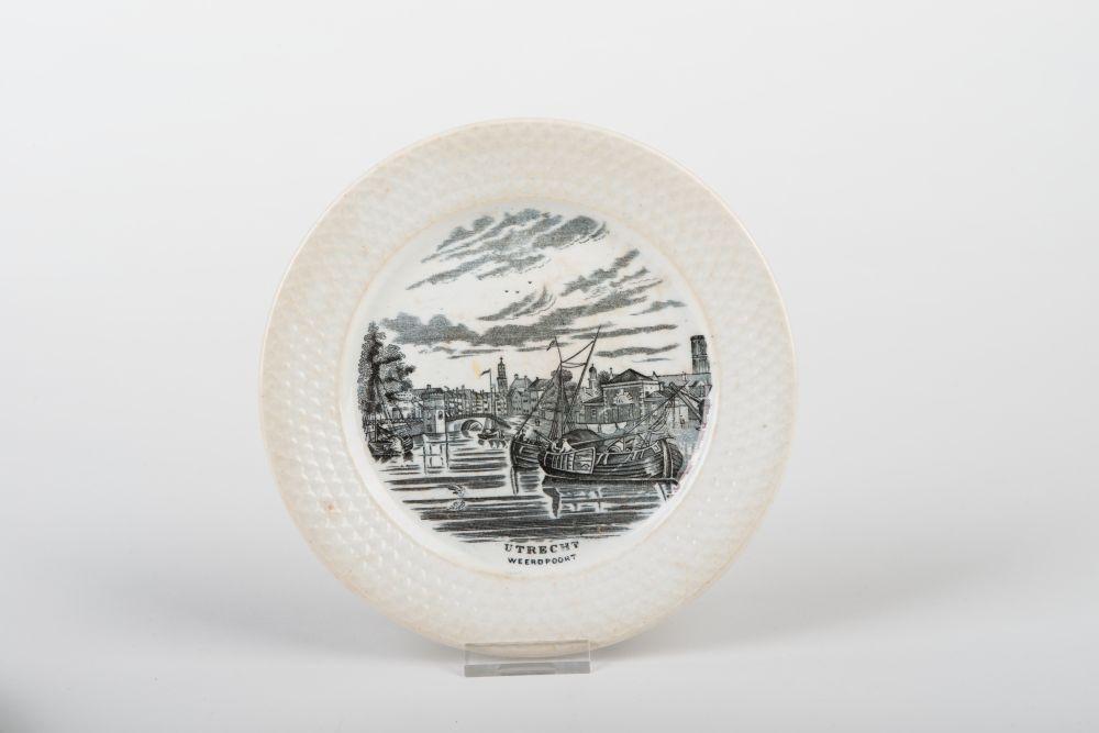 Nederlands bord met stadsgezicht