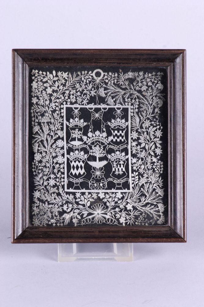 Papierknipsel met heraldische symbolen