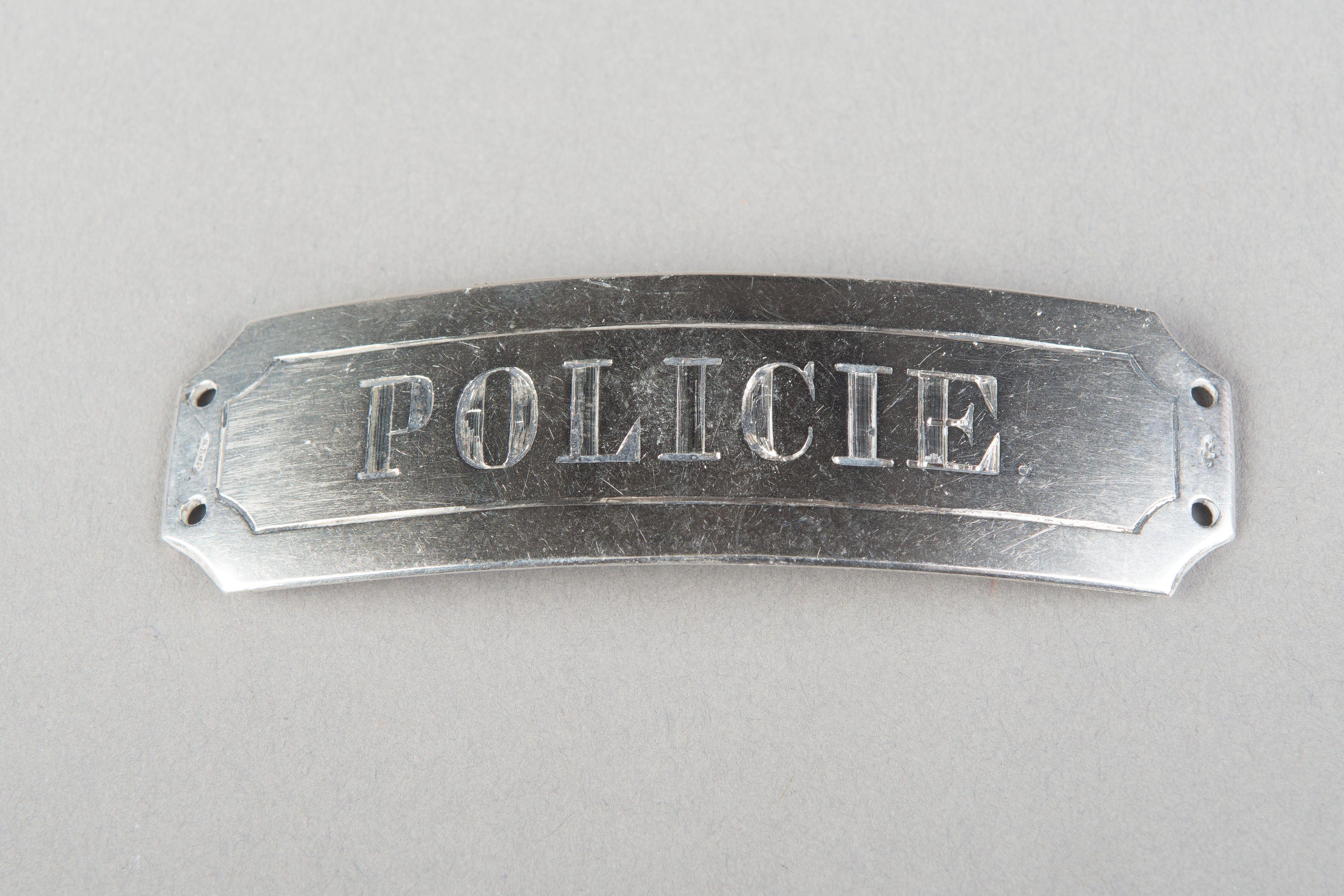 Zilveren insigne van de politie door R. Reynders