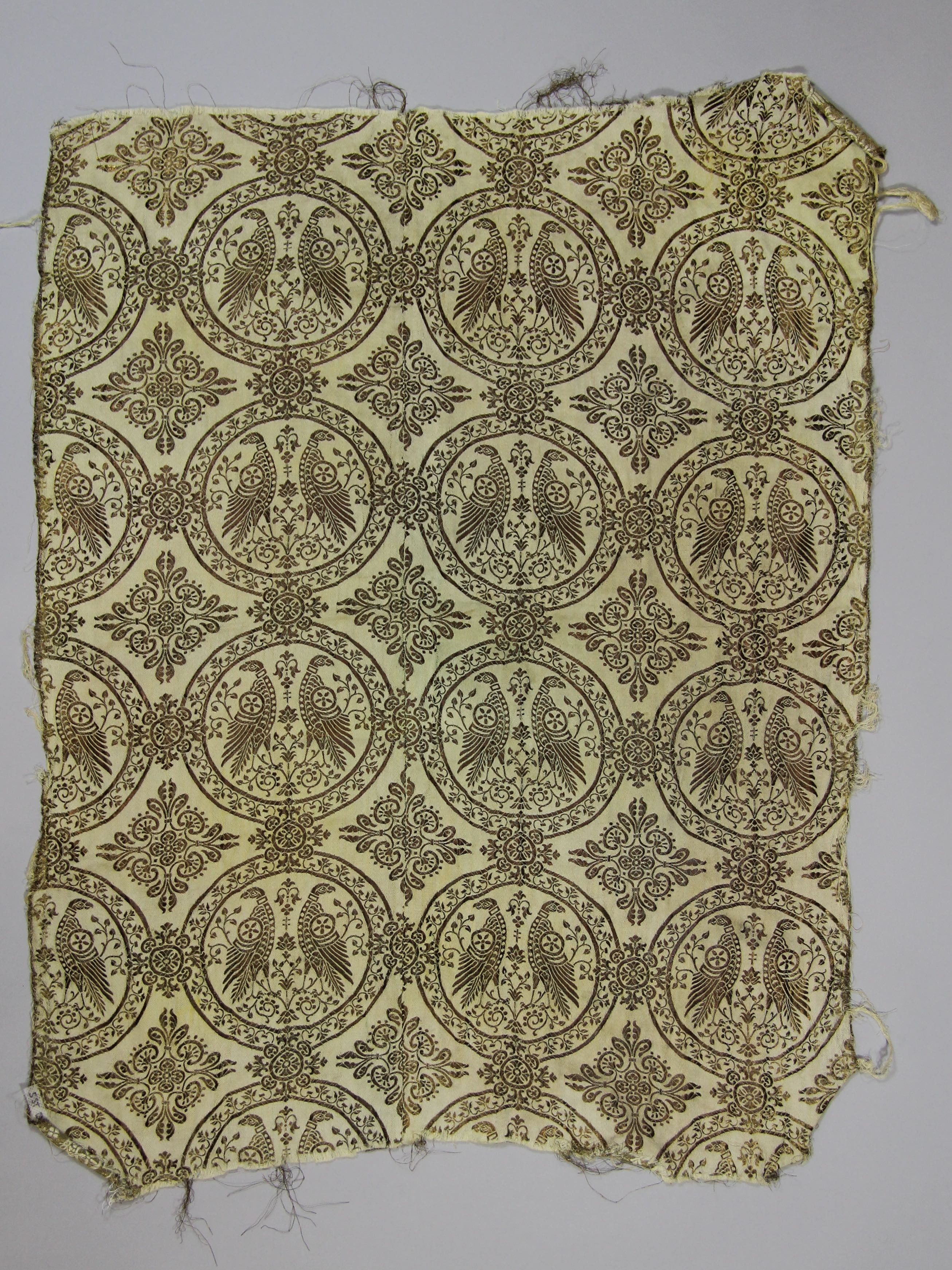 Fabric with golden roundels (fragment)