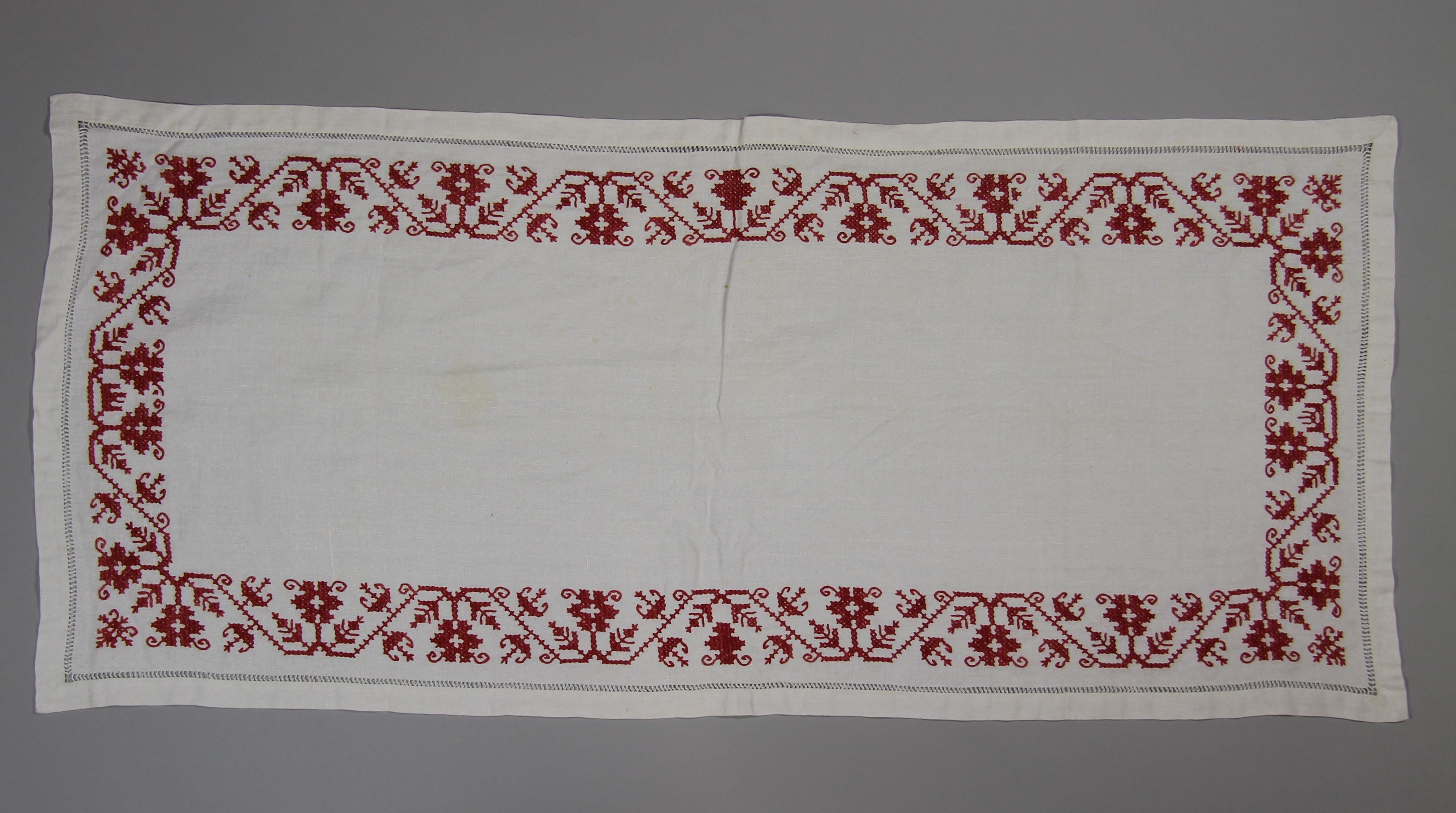 Embroidered coverlet