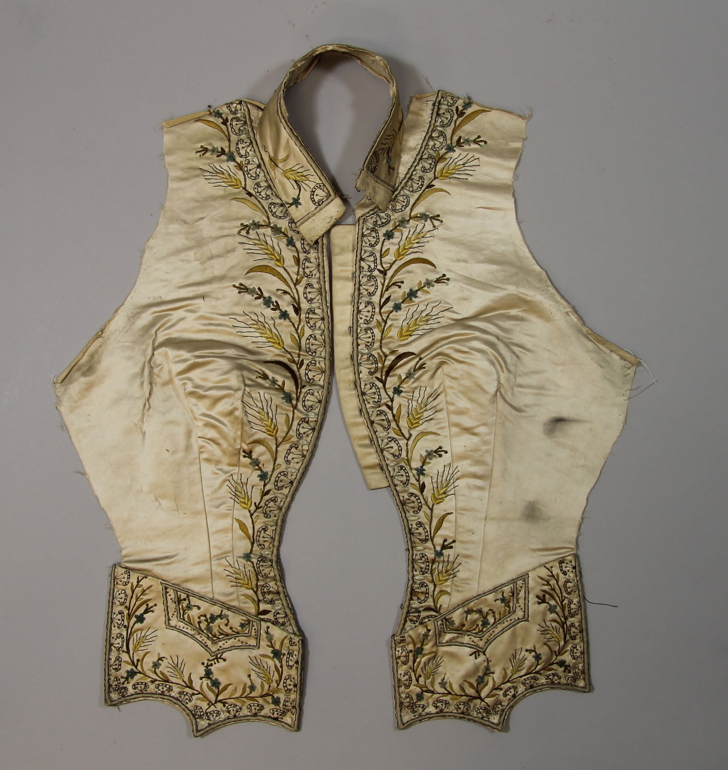 Two front sections of a woman's embroidered vest