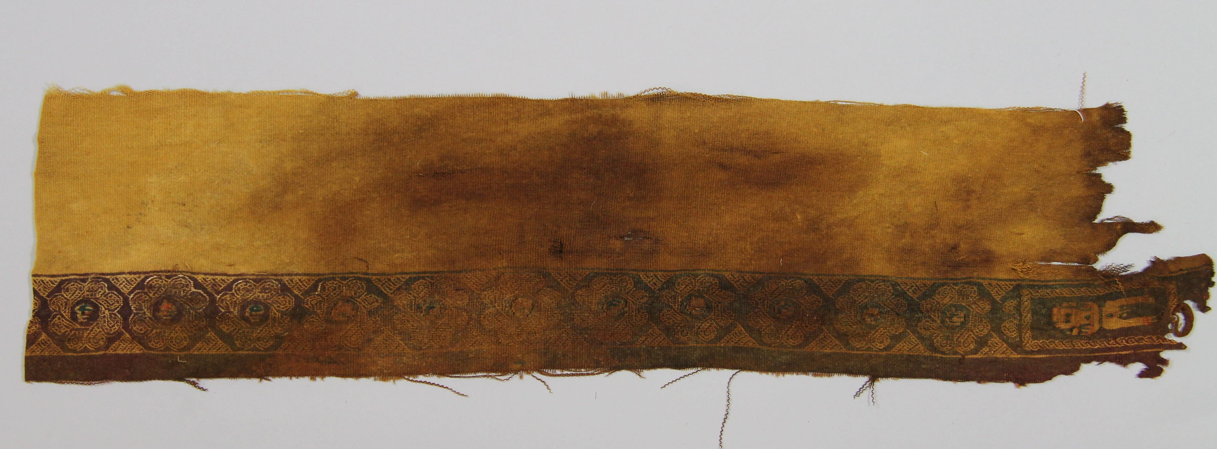 Part of a garment (fragment)