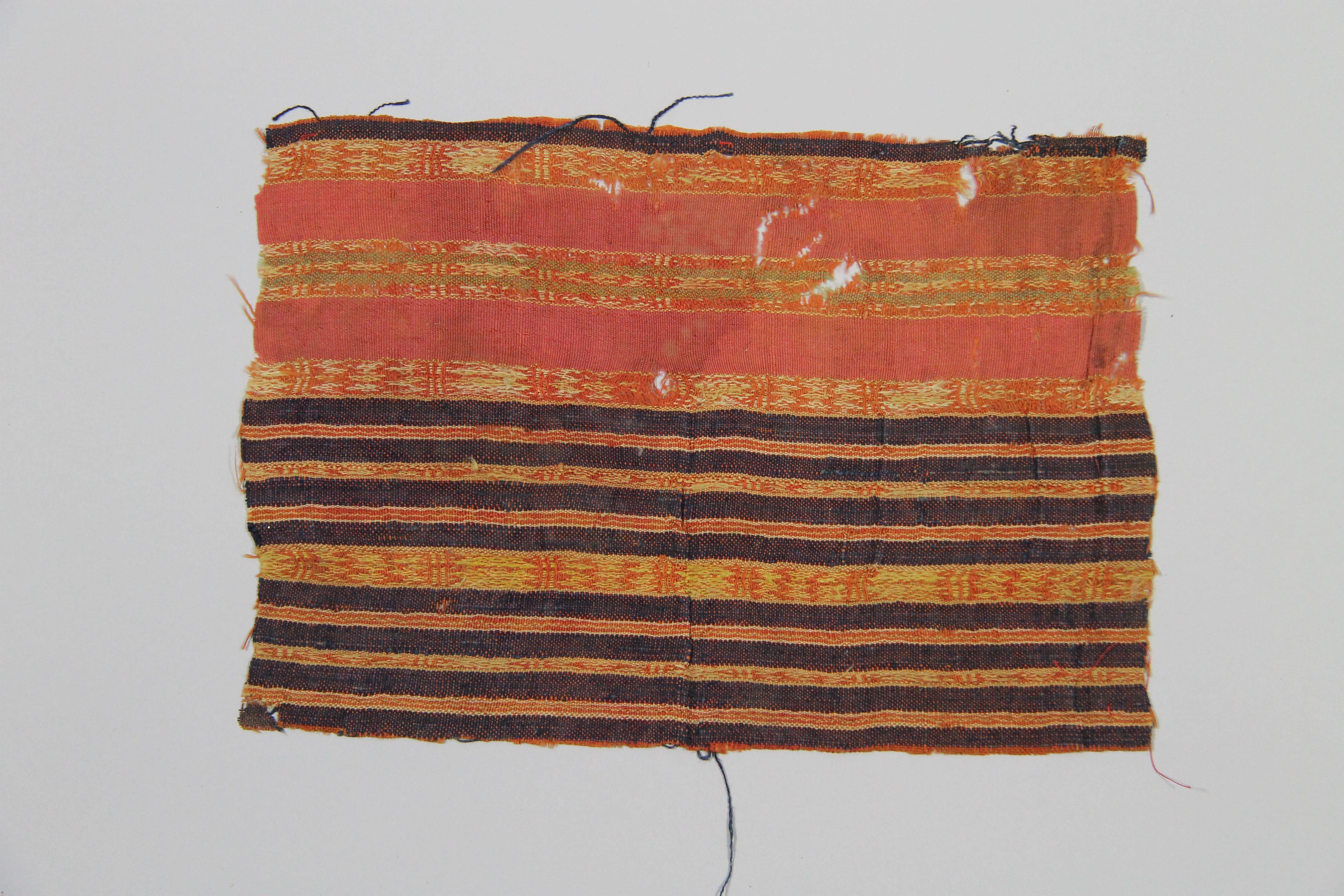 Striped woven textile (fragment)