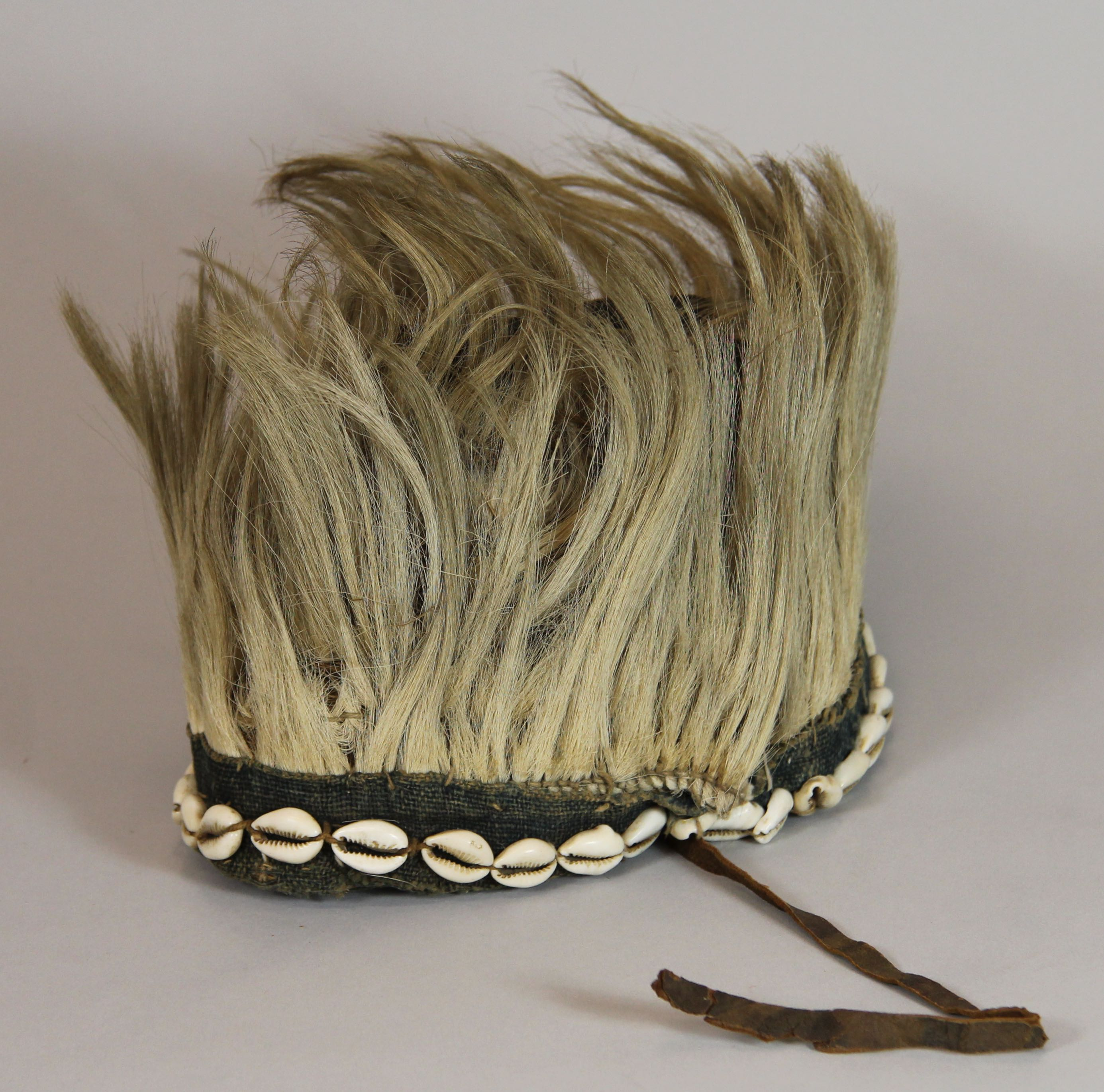 Headdress with hair and shells