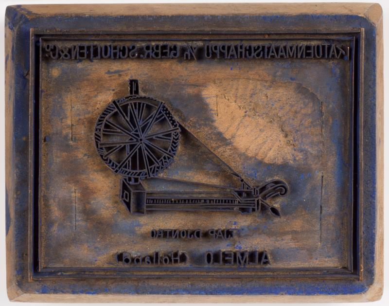 """Exportstempel: """"N.V. Katoenmaatschappij v/h Gebr. Scholten en Co. Almelo"""""""
