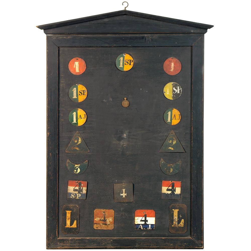 Wandbord met brandweeronderscheidingstekens