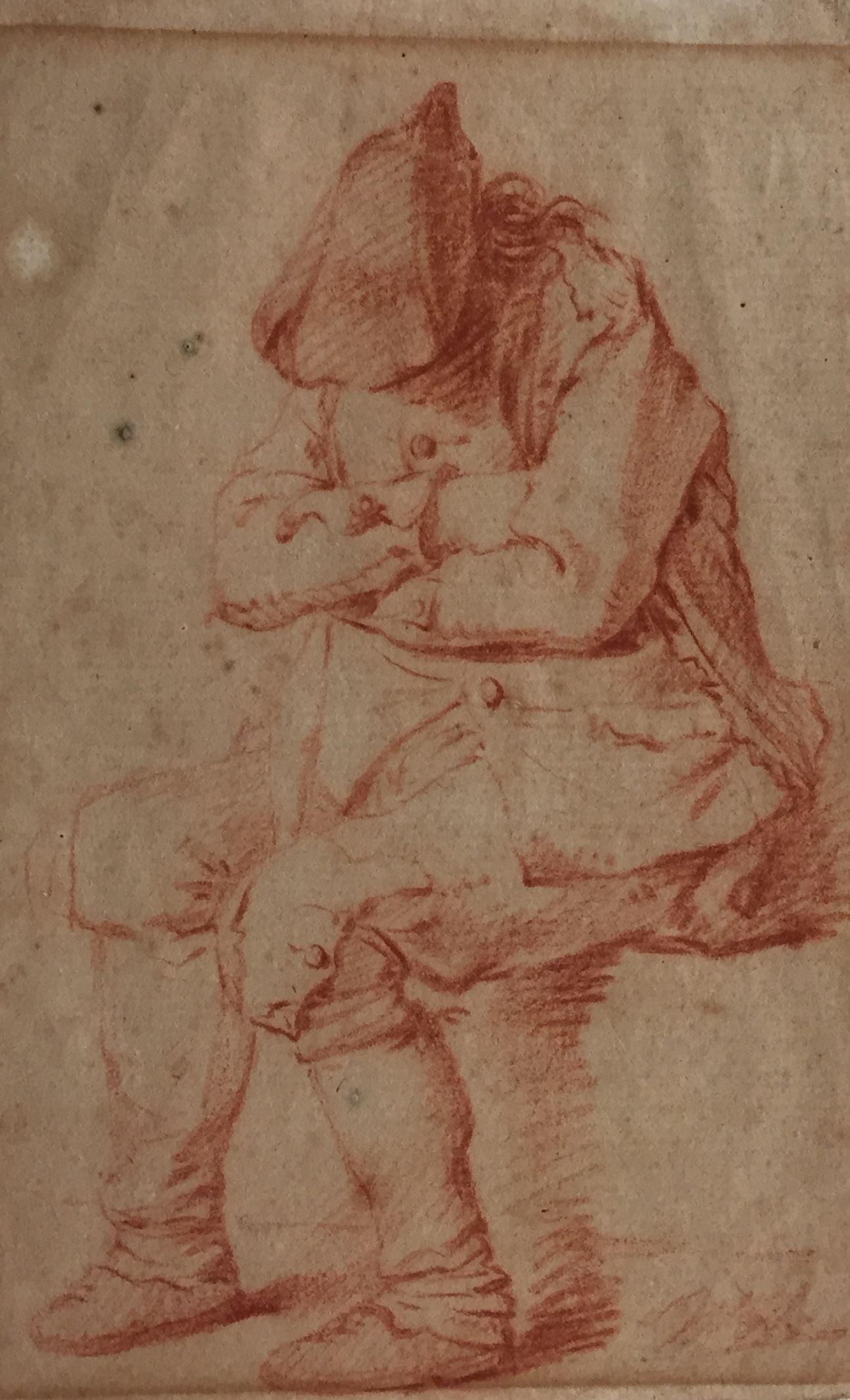 Slapende man, zittend met hoed